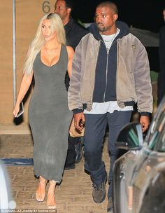 Curves for days! Kim Kardashian looked every bit the bombshell Friday as she stepped out for date night with hubby Kanye West in Malibu