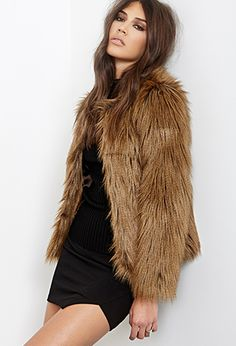 Forever 21 faux fur jacket gift idea for your girlfriend   25 Killer Christmas Gift Ideas for your girlfriend here: http://www.kailayu.com/25-killer-christmas-gifts-for-your-girlfriend/