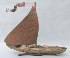 Driftwood and vintage metal sailboat by RL Brethauer. https://www.facebook.com/artbyrl www.rlbrethauer.com Story coming soon!