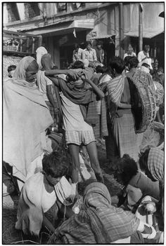 Crowd in street.. From Duke Digital Collections. Collection: William Gedney Photographs and Writings. Mark: None. Date of print: Unknown.