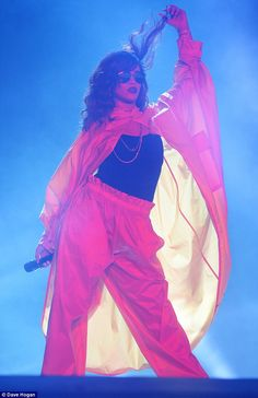 Don't stop the music! Rihanna played with her hair as she performed at Rock In Rio on Satu...