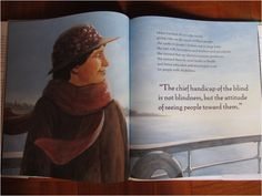 """A photo of the book 'Helen's Big World: The Life of Helen Keller', in open position, showing two pages. The right page contains eight lines of text and one quotation in larger writing below it. The quotation reads """"The chief handicap of the blind is not blindness, but the attitude of seeing people toward them"""". The illustration is continuous across the two pages. In the background is a pale blue sky and a slightly darker blue sea. The woman from the front cover looks older now. She is…"""