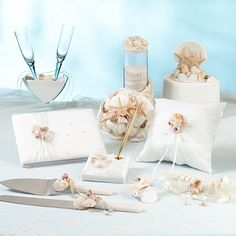 The Oceans Away Collection by Lillian Rose will take you to a beautiful destination or favorite beach. Oceans Away Wedding Accessories include a guest book & pen set, toasting flutes, cake serving set, cake topper and more. My Wedding Favors, Destination Wedding, Wedding Ideas, Beach Cake Topper, Shell Bouquet, Unique Cake Toppers, Lillian Rose, Beach Cakes, Ivory Wedding