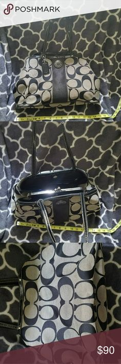 Large black and gray Coach Purse Large Coach Purse with a center pocket.  This purse is used but has a lot of life left. Coach Bags Shoulder Bags