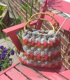 "Crochet:  free ""Catherine Wheel Tote"" pattern.  I think I would make crocheted handles instead of wood handles."