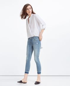 Light blue mid-rise frayed hem jeans