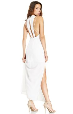 A summer wedding calls for our Countdown Maxi Dress from Keepsake. This gorgeous number features a high neckline, fitted bodice, skinny back straps, a concealed back zipper closure, and sexy side slits. Look like you just stepped off the catwalk by adding slicked back tresses and faux lashes.