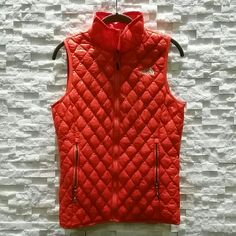 Beautiful orange North Face vest on Poshmark