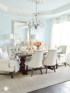 Elegant Dining Room with Lauren's Surprise Blue Paint and Tray Ceiling with Elegant Crystal Chandelier