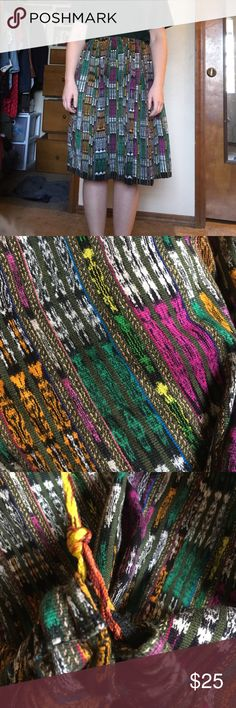 Handmade Guatemalan midi skirt!one size fits all Bought this from a man in Guatemala a few years ago! Beautiful, bright, unique colors! It has a drawstring to adjust to literally any size!  I put in some elastic that can very easily be cut out (string and elastic in picture) just because I wanted it to be easy to wear! Also very good quality, heavy fabric. Purple, green, orange, white, yellow, black, gray Handmade Skirts Midi