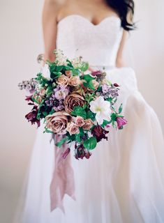 Jewel toned rose, parrot tulip, and astilbe wedding bouquet: Photography: Jose Villa Photography - josevillaphoto.com   Read More on SMP: http://www.stylemepretty.com/2016/11/15//
