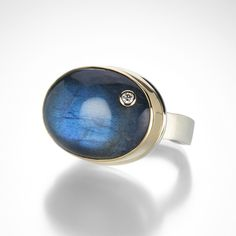 Looking to start building a Jamie Joseph collection?  This labradorite ring is the perfect place to begin!  The oval gem is polished to a high shine and boasts Jamie's signature offset diamond 'Freckle.'  Just the right size for everyday, the stone is framed by a 14k yellow gold bezel and sits on a sterling silver 'Live Edge' band. @QUADRUM
