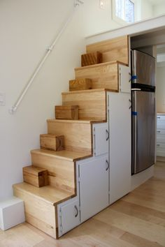 Storage stairs with removable blocks on stairs to make puppy dog climbing easier!