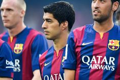 Luis Suarez (C) of FC Barcelona looks on during the official presentation of the FC Barcelona prior to the Joan Gamper Trophy match between FC Barcelona and Club Leon at Camp Nou on August 18, 2014 in Barcelona, Catalonia.