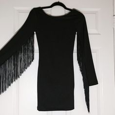 Fringe Sleeve Bodycon Dress Form fitting black dress with cool fringed sleeves! Sexy low back. I love this dress but it's a bit tight on me.  I've tried this on but never wore out. H&M Dresses Mini