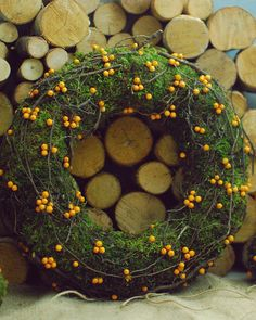 Natural wreath created from moss, decorated with flax balls and twigs. beautiful for front door or as centerpiece. Check it out in shop