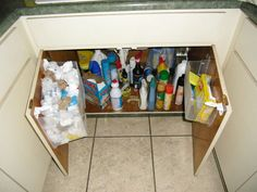 Under the kitchen sink bag storage Don't those plastic bags from the grocery store pile up? Here is a way to store them out of the way.