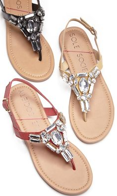 Flat sandals bejeweled in sparkling crystal stones along the t-straps. Perfect for spring & summer.
