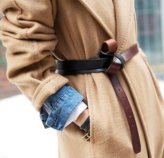 Denim jacket under a camel wool coat