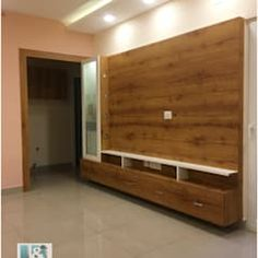 Puja cum tv unit modern living room by u and i designs modern Design Hall, Flur Design, Hall Interior Design, Plafond Design, Interior Design Living Room, Living Tv, Living Room Tv Unit, Modern Living, Living Area