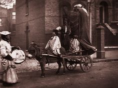 """Bonfire night 1876 - picture of the day  """"This image of a guy being pulled on a donkey cart was taken by Scottish photographer John Thompson and published in Street Life in London, a groundbreaking monthly magazine which he published with his collaborator, the radical journalist Adolphe Smith. The publication, which lasted a year, was a pioneering project to document the everyday lives of working class Londoners  Photograph: John Thomson/ Hulton Archive/Getty Images"""""""