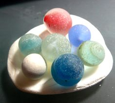 Seven sea glass marbles from NE England by jazomir on Etsy, $24.00