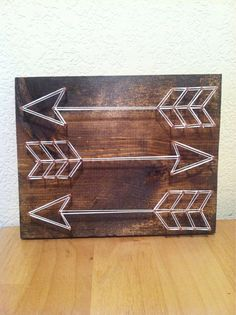 Customize your own arrow string art on a 7x9 solid wood board.