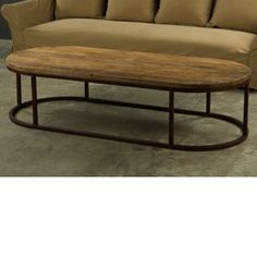 A large, simple oval coffee table from BoBo.  This beautiful coffee table is constructed of reclaimed wood top with waxed rust metal base.  Imported from Europe.   Please note that items from BoBo Intriguing Objects are imported from Europe and the time it takes to receive these Intriguing Objects will vary. Should you have any questions regarding a timeline for these, or any of our products, please call our friendly staff at 1-800-440-5121.