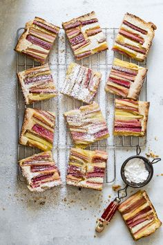 Sweet and tart lemon bars topped with fresh rhubarb and baked in a buttery pastry crust.