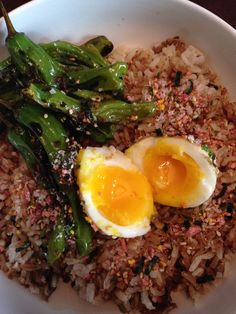 Low on supplies, so I used my wonderful shishito peppers, a soft-boiled egg (this ended up medium though :P) over a bed of brown rice, seasoned with Ebi... Furikake (kimchi rice seasoning) and tadah!! Yummy, healthy and sustaining!   Photo by Mia T. Medeiros  #healthfood #japanesefood #improvising