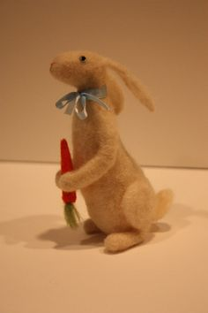 This bunny stands about 6 tall, and is needle felted from the wool of our Border Leicester sheep. He is holding a carrot, which is attached, and is also needle felted. He is a little work of art and would look charming displayed on a shelf or table, but is not intended as a toy for a young child.  This is a MADE TO ORDER item and the wait is approximately 2 weeks. This wait time is an estimate, so please contact me if you are concerned about the time frame. All made to order items must be…