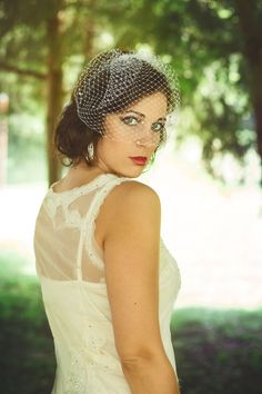 Add soft vintage glamour to your wedding with this Swarovski crystal scattered birdcage veil from Rose Red Bridal Designs.