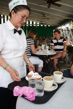 Beignets at Café du monde. The café opened its doors in the 1860s. And has ever since been the place for café au lait and beignets. The latter is ways served in pairs of three. From Nordic Diner