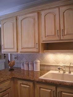 painted cabinets: linen white and rich brown glaze... (This is what I want to do to my old oak cabinets!!!)