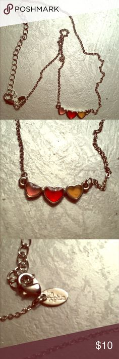 "Lia Sophia Triple Heart Necklace Delicate triple heart necklace. The middle heart is red and the two outer are orange. 12"" chain. Lia Sophia Jewelry Necklaces"