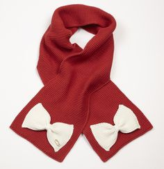 A-Dee red scarf (matching hat available) with cream bow detail.