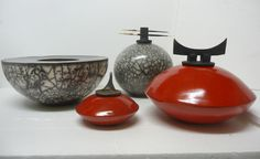 I know little about Raku and less about how it is created, but I believe I do know beauty and tthese are beautiful...Red Raku and Naked Raku series by Judith Paisley.
