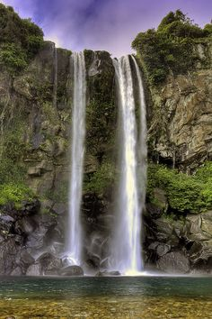 """Jeongbang Waterfall, Jeju, South Korea - The only waterfalls in Asia that fall directly into the ocean - The beautiful """"Island of the Gods"""" lies off the southern coast of South Korea. It's reputed to have some of the cleanest and purest water in the world."""