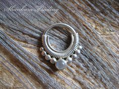 Tribal Silver Septum Ring, 1mm, 18 Gauge, Septum Jewelry, Opal, Indian Nose Ring, Septum Piercing by ShankaraTrading on Etsy https://www.etsy.com/listing/212394470/tribal-silver-septum-ring-1mm-18-gauge