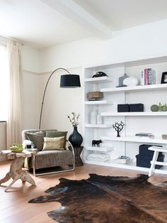Modern bookself contemporary family room, like the placement of different size shelves.