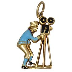 CARTIER Gold  Enamel Movie Camera Charm | From a unique collection of vintage more jewelry at https://www.1stdibs.com/jewelry/more-jewelry-watches/more-jewelry/