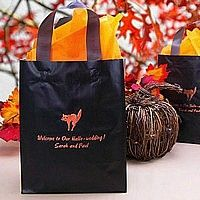 Personalized black frosted poly gift bag printed with Bronze Satin imprint, HW2 Halloween design, and three lines of print in Hauser lettering style