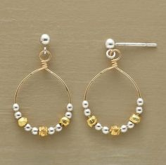 """Smooth sterling silver beads buddy up with hammered beads dipped in 24kt gold. Together, they slide along wire hoops on sterling silver posts. Securing earring backs included. Exclusive. Handmade in USA. 1""""L."""