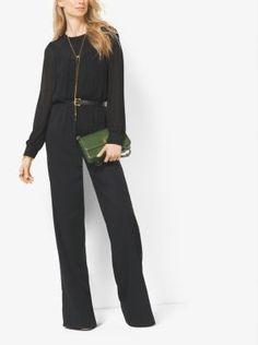 The key to a refined yet modern evening ensemble is a jumpsuit. Ours is updated for the season in fashion's favorite wide-leg silhouette. Shirring and a cinched waist flatter the figure, while a back keyhole finishes this powerhouse piece with a flirty note.