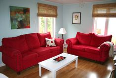 Love the light blue walls with red furniture. Living room!