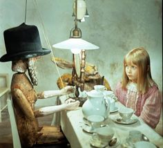 Film still of Alice and the Mad Hatter, from Jan Svankmajer's Alice, 1988 uses puppetry and stop-frame animation. Not only does it utilize the tactile, old-school cinematic techniques to which the Alice stories lend themselves so beautifully, but it embraces the underlying discomfort sensed in the original books, and which so many more romantic, beautified versions overlook.