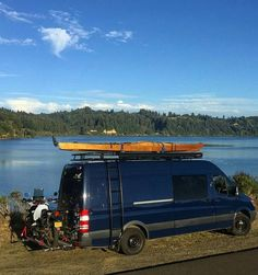 Mercedes Sprinter with Aluminess roof rack and ladder.  Beautiful spot by the river in Oregon.
