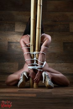 Tied nude babe, tied to bamboo tubes. Sample image of the @fineartofbondage project.More images here: http://fineartofbondage.tumblr.com/GalleryThis image is also available as poster/fine art print: http://fineartamerica.com/featured/nude-tied-to-a-bamboo-tube-fine-art-of-bondage-rod-meier.htmlPhotography: Rod Meier, Ulm