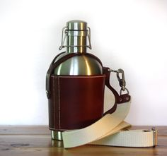 SS Growler Leather Carrier w/ Shoulder Strap and Stainless Steel Beer Growler by PedalHappyDesign on Etsy https://www.etsy.com/listing/159061761/ss-growler-leather-carrier-w-shoulder