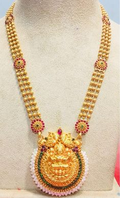 Beautiful gold long haaram with lakshmi devi pendant. Long haaram chain with triple layer ball chain. Long haaram studded with multi color precious stones. 14 March 2018